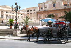 Horse carriages on Piazza Pretoria with magnificent fountain Royalty Free Stock Images