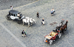 Horse carriages and tourists in the Old Town of Prague. Royalty Free Stock Images