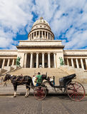 Horse carriages waiting for tourists in Havana Stock Photo