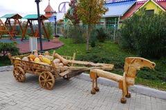 Horse carries a cart with pumpkins. Halloween Stock Photos