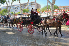 Horse cars at the fair in Seville. The Seville Fair generally begins two weeks after the Holy Week in april. For the duration of the fair, the fairgrounds are stock photos