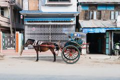 Horse cart. Bagan , Myanmar - October 21, 2016: Horse cart on the street near Mani Sithu Market in Nyaung-U village, Bagan, Myanmar (Burma Royalty Free Stock Photos