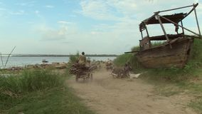 Horse cart, bamboo, cambodia, southeast asia. Southeast asia, cambodia, koh pene , december  2013. Men ride horse cart to transport  bamboo on path track (4 stock footage