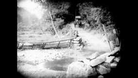 Horse cart crossing pool on street stock footage