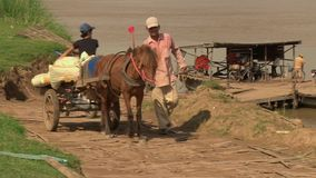 Horse cart, ferry boat, cambodia, southeast asia stock footage