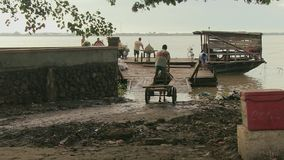 Horse cart, Ferry boat , mekong, cambodia, southeast asia stock video footage