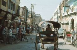 1977. India. Horse cart, on the main street. The picture shows the traffic on the main street, horse cart, bicycle rickshaw, people with bicycles and Stock Photo