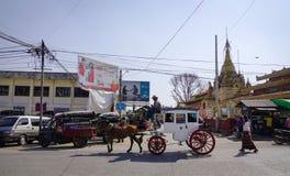 Horse cart in Pyin Oo Lwin, Myanmar. Pyin Oo Lwin, Myanmar - Feb 12, 2017. A horse cart running on street in Pyin Oo Lwin, Myanmar. The small town of Pyin Oo Stock Image