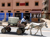 A horse and cart riding down the road in the Anti Atlas mountains, Morocco. Stock Images