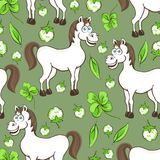 Horse cartoon drawing seamless pattern, vector illustration. Funny cute painted white horse flowers and clover leaves on green bac Stock Photos