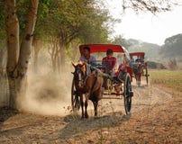 Horse carts on rural street in Bagan Stock Photo
