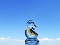 Horse chess. Of glass on blue sky stock photo