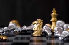 Horse chess set and win with enemy background.  Royalty Free Stock Photography
