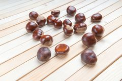 Horse Chestnut for Christmas on wooden background.  royalty free stock image