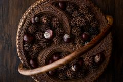 Horse Chestnuts in wooden basket. Organic Food Stock Images