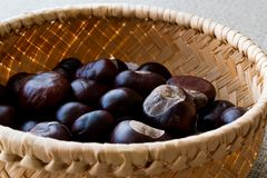 Horse Chestnuts in wooden basket. Organic Food Royalty Free Stock Photos