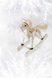 Horse christmas decoration on white snow background Royalty Free Stock Photo