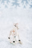 Horse christmas decoration on white snow background Royalty Free Stock Images