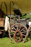Horse collar rest on a covered wagon wheel Stock Image