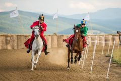 Horse contest ,during a horse show with young riders. Young horse riders on horses parade and contest , with costume, running the marathon Royalty Free Stock Photography