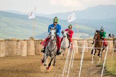 Horse contest ,during a horse show with young riders. Young horse riders on horses parade and contest , with costume, running the marathon Royalty Free Stock Images