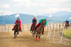 Horse contest ,during a horse show with young riders. Young horse riders on horses parade and contest , with costume, running the marathon Stock Photo