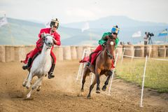 Horse contest ,during a horse show with young riders. Young horse riders on horses parade and contest , with costume, running the marathon Stock Photos