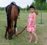 Horse and cute jockey Royalty Free Stock Photo