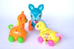 Horse deer giraffe plastic baby toys royalty free stock photos