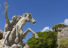 Horse detail of Raices Statue. SAN JUAN, PUERTO RICO - MARCH 8, 2015: The Raices Fountain, celebrating the diversity of the population, stands dry under a blue stock images