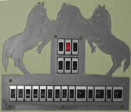 Horse and dolphin on switch board Stock Images