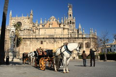 Horse-drawn barouche waiting for turists in Seville Stock Photography
