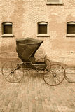 Horse-drawn carriage. An old horse-drawn carriage done in sepia Royalty Free Stock Photos