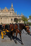 Horse drawn carriage and Cathedral, Seville. Stock Images
