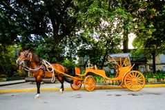 Horse drawn carriage in front of Intramuros, Manila, Philippines royalty free stock images