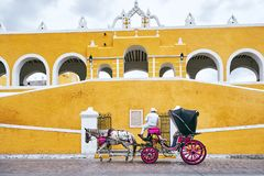 YUCATAN, MEXICO - MAY 31, 2015: Horse carriage in the yellow city of Izamal stock image