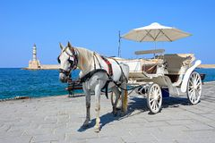 Horse drawn carriage and lighthouse, Chania. Royalty Free Stock Image