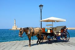 Horse drawn carriage and lighthouse, Chania. Royalty Free Stock Photo