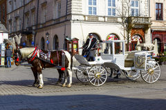 Horse-drawn carriage at Market Square of Krakow Royalty Free Stock Photo