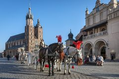 Horse drawn carriage on Old Town square in Krakow Royalty Free Stock Images