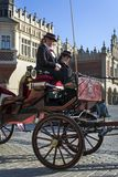 Horse drawn carriage on Old Town square in Krakow. KRAKOW, POLAND - MARCH 13: Hansom cab waiting to whisk tourists around the beautiful city of Krakow on March stock image