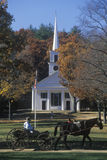 Horse drawn carriage outside of steeple church Royalty Free Stock Photo