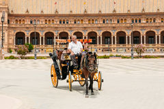 Horse drawn carriage in Plaza de Espana in Seville, Andalusia. Royalty Free Stock Photography