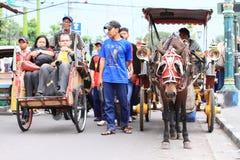 Horse-drawn carriage and rickshaw royalty free stock photo