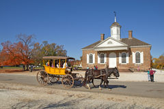 A horse-drawn carriage rides in front of the courthouse building Royalty Free Stock Image