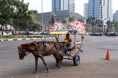 Horse drawn carriage in the streets of Jakarta Royalty Free Stock Photography