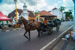 Horse drawn carriage in the streets of Jogjakarta Stock Photography