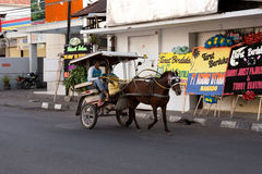 Horse drawn carriage in the streets of Manado Royalty Free Stock Photo