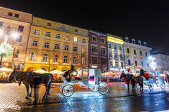 Horse-drawn Carriage before the Sukiennice on The Main Market Square in Krakow Royalty Free Stock Photo