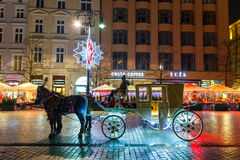 Horse-drawn Carriage before the Sukiennice on The Main Market Square in Krakow Stock Photos